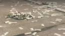 Armored truck showers highway with $  600k in cash