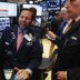 Wall St. falls as FBI to review more Clinton emails