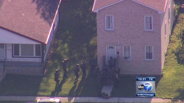 2 children, 2 adults held hostage in Harvey; 2 officers shot