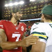 Colin Kaepernick says he'll continue to sit during national anthem