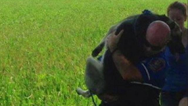 Police Officer's Dog-Rescue Heroics Go Viral