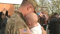 Tears of joy: Returning soldier meets child for first time