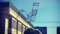 Ad banner falls from plane onto power lines in SF