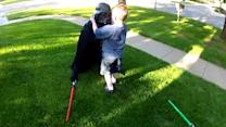 Navy Reservist Surprises Son At Home Dressed as Darth Vader