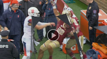 It's not every day you see a *quarterback* start a sideline shoving match