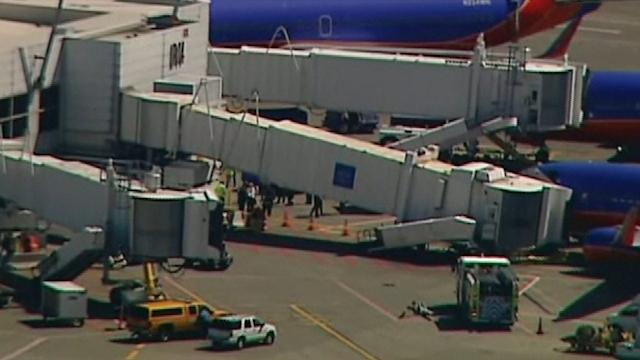 SOUTHWEST JETWAY DROPS AS PASSENGERS DE-PLANE