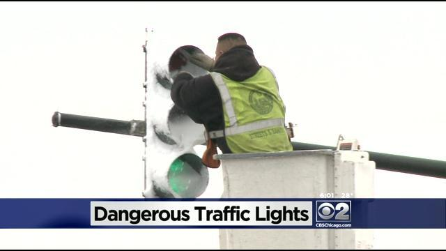 Wet, Blowing Snow Covers Some Traffic Signals