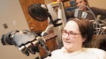 Quadriplegic Feeds Herself With Robotic Arm
