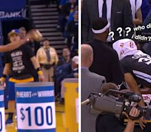 Steph Curry leaves timeout huddle to help fan win $5,000