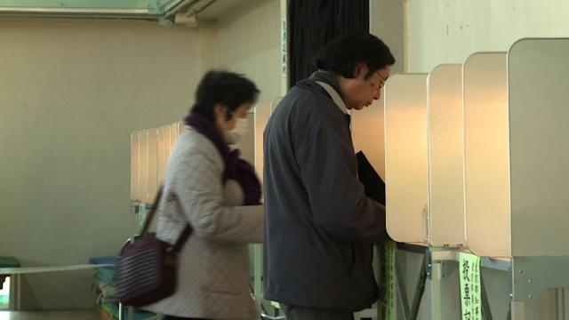 Japan conservatives sweep to victory in polls