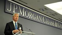 JPM's Dimon buys $26.6M of company stock; Groupon surges on earnings beat; FireEye warns of spending slowdown