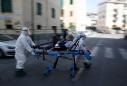 Italy's coronavirus deaths push higher, new cases hold steady