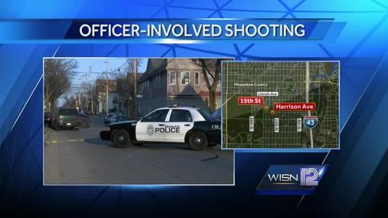 Man holding rifle shot by officers