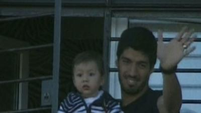 Raw: Suarez Returns Home After World Cup Bite