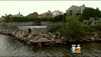 Homeowner Battles Government Over Seawall