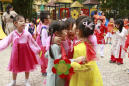 Hanoi Postcard: Children hope to give Kim comradely welcome