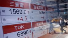China stocks fall after rating cut, other Asian markets gain