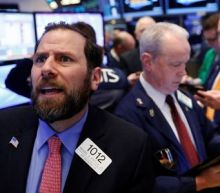 Wall Street dips in dramatic session as health bill pulled