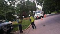 Cleanup time: Workers restore power to thousands