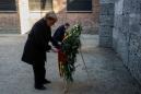 Merkel expresses 'shame' during Auschwitz visit, vows to fight anti-Semitism