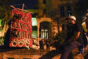 Some Breonna Taylor protesters out past curfew, fires set
