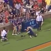 Woman tries to catch Auburn kickoff and gets hit right in the face, and she's OK!
