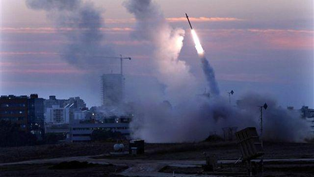 Report: Israel's 'Iron Dome' shoots down dozens of rockets